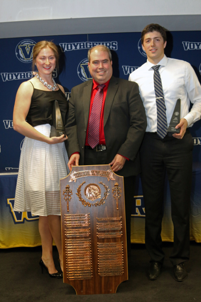 Emily Jago (left) and Vincent Llorca (right) are recognized as Female and Male Athlete of the year by Laurentian president Dominic Giroux