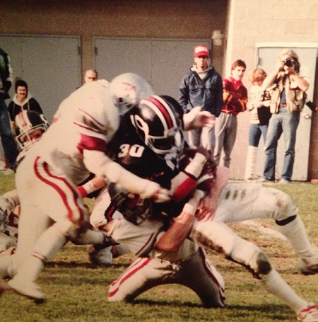 Shown here making one of the countless tackles he would record during his days as an Ottawa Gee Gee, local football man Mike Fabiilli will be enshrined in the team Hall of Fame