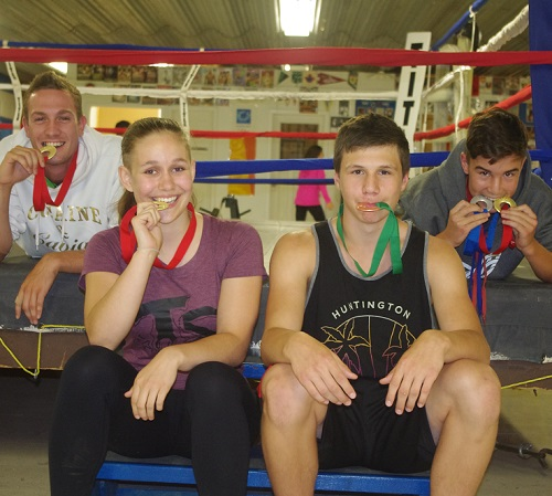 Lance Chretien, Justin Labelle and Brett Huard of the Valley East Boxing Club join with training partner and kickboxing gold medal winner Emilie Charette, celebrating the success of the quartet at the 2016 Ontario Summer Games